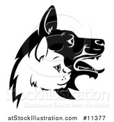 Vector Illustration of a Black and White Profiled Dog and Cat Faces by AtStockIllustration