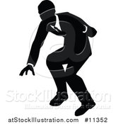 Vector Illustration of a Black and White Silhouetted Business Man by AtStockIllustration