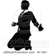 Vector Illustration of a Black and White Silhouetted Business Man Kneeling by AtStockIllustration