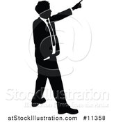 Vector Illustration of a Black and White Silhouetted Business Man Pointing by AtStockIllustration