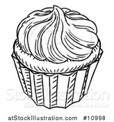 Vector Illustration of a Black and White Vintage Engraved Cupcake by AtStockIllustration