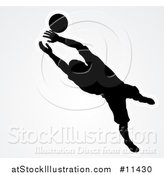 Vector Illustration of a Black Silhouetted Goal Keeper Soccer Player Blocking the Ball, over Gray by AtStockIllustration