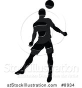 Vector Illustration of a Black Silhouetted Male Soccer Player Heading a Ball by AtStockIllustration