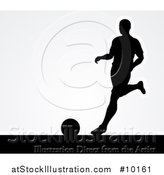 Vector Illustration of a Black Silhouetted Male Soccer Player Kicking over Gray by AtStockIllustration