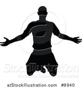 Vector Illustration of a Black Silhouetted Male Soccer Player Kneeling or Jumping by AtStockIllustration