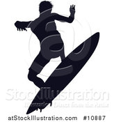 Vector Illustration of a Black Silhouetted Man Surfing by AtStockIllustration