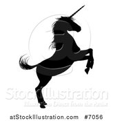 Vector Illustration of a Black Silhouetted Rearing Unicorn in Profile, Facing Right by AtStockIllustration