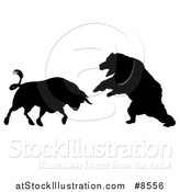 Vector Illustration of a Black Silhouetted Stock Market Bull Fighting a Bear by AtStockIllustration