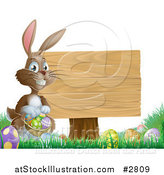 Vector Illustration of a Brown Easter Bunny Holding a Basket of Eggs by a Wood Sign in Grass by AtStockIllustration
