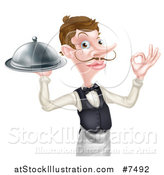 Vector Illustration of a Cartoon Caucasian Male Waiter with a Curling Mustache, Holding a Cloche Platter and Gesturing Ok by AtStockIllustration