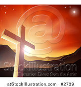 Vector Illustration of a Christian Cross Against a Sunset and Mountains by AtStockIllustration