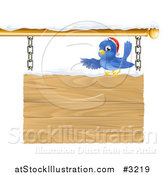 Vector Illustration of a Christmas Robin with a Santa Hat Pointing over a Snow Covered Wooden Sign by AtStockIllustration