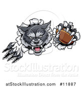Vector Illustration of a Ferocious Gray Wolf Slashing Through a Wall with a Football by AtStockIllustration