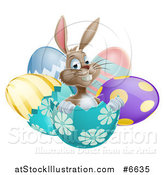 Vector Illustration of a Happy Brown Easter Bunny Sitting in an Egg Shell by AtStockIllustration