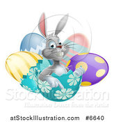 Vector Illustration of a Happy Gray Easter Bunny Sitting and Pointing from an Egg Shell by AtStockIllustration