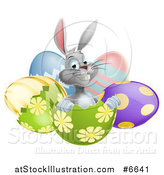 Vector Illustration of a Happy Gray Easter Bunny Sitting in an Egg Shell by AtStockIllustration