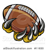 Vector Illustration of a Monster or Eagle Claws Holding a Football by AtStockIllustration