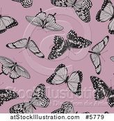 Vector Illustration of a Seamless Background Pattern of Butterflies on Pink by AtStockIllustration