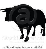 Vector Illustration of a Silhouetted Black Bull by AtStockIllustration