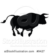 Vector Illustration of a Silhouetted Black Bull Charging by AtStockIllustration
