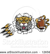 Vector Illustration of a Vicious Wildcat Mascot Shredding Through a Wall with a Football by AtStockIllustration