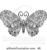 Vector Illustration of an Elegant Butterfly with Swirls on Its Wings by AtStockIllustration