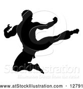 Vector Illustration of an Unstoppable Silhouetted Martial Artist Kicking by AtStockIllustration