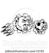 Vector Illustration of Black and White Vicious Aggressive Bear Mascot Slashing Through a Wall with a Soccer Ball in a Paw by AtStockIllustration