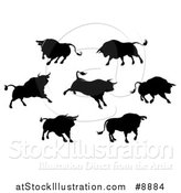 Vector Illustration of Black Silhouetted Bulls by AtStockIllustration