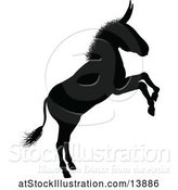 Vector Illustration of Black Silhouetted Donkey Rearing by AtStockIllustration