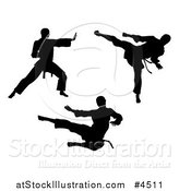 Vector Illustration of Black Silhouetted Karate and Martial Arts Men by AtStockIllustration