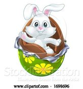 Vector Illustration of Easter Bunny Rabbit Breaking out of Chocolate Egg by AtStockIllustration