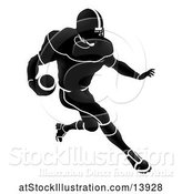 Vector Illustration of Silhouetted Black and White Football Player Charging by AtStockIllustration