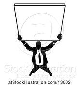 Vector Illustration of Silhouetted Businessman Holding up a Sign by AtStockIllustration