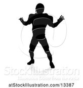 Vector Illustration of Silhouetted Football Player with a Reflection or Shadow, on a White Background by AtStockIllustration