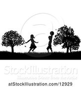 Vector Illustration of Silhouetted KChildren Playing in a Park by AtStockIllustration