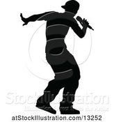 Vector Illustration of Silhouetted Male Singer by AtStockIllustration