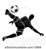Vector Illustration of Silhouetted Male Soccer Player Jumping and Kicking by AtStockIllustration