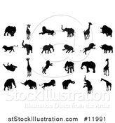 Vector Illustration of Silhouetted Safari Animals by AtStockIllustration