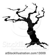 Vector Illustration of Silhouetted Spooky Bare Tree by AtStockIllustration