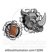 Vector Illustration of Tough Rhino Monster Mascot Holding a Football in One Clawed Paw and Breaking Through a Wall by AtStockIllustration